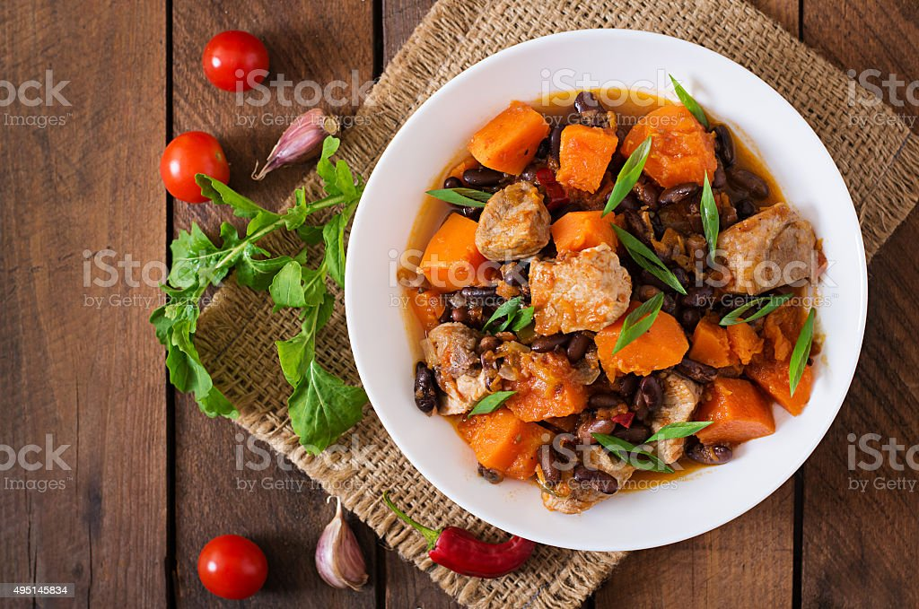 Baked spicy pumpkin with meat and beans stock photo