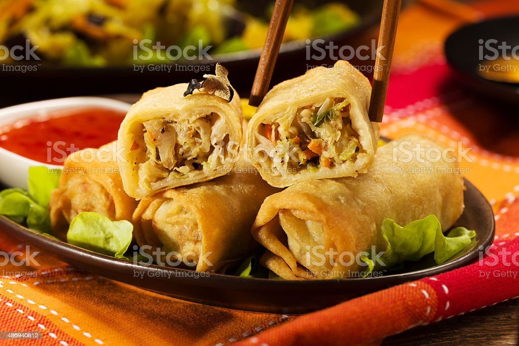 Baked spring rolls with deep, vegetables and rice. stock photo