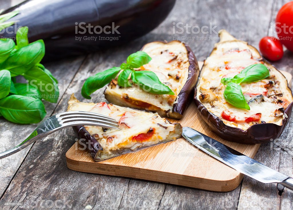Baked stuffed eggplant with cheese and tomatoes stock photo