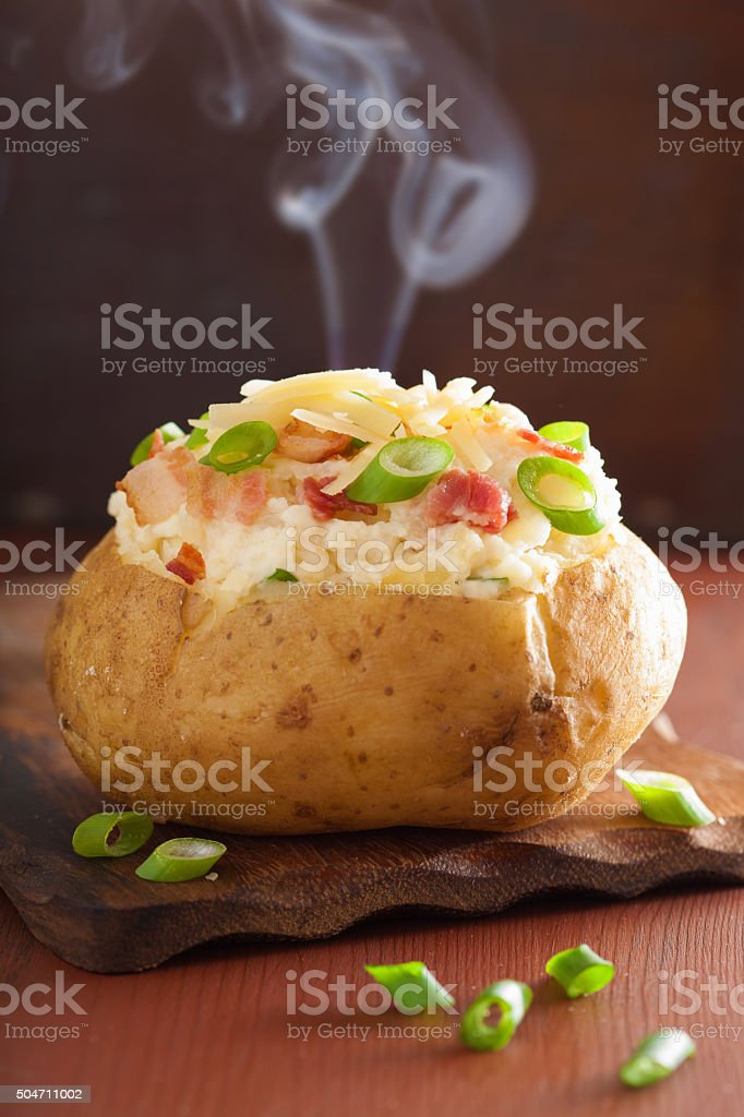 baked stuffed potato in jacket with bacon and cheese stock photo