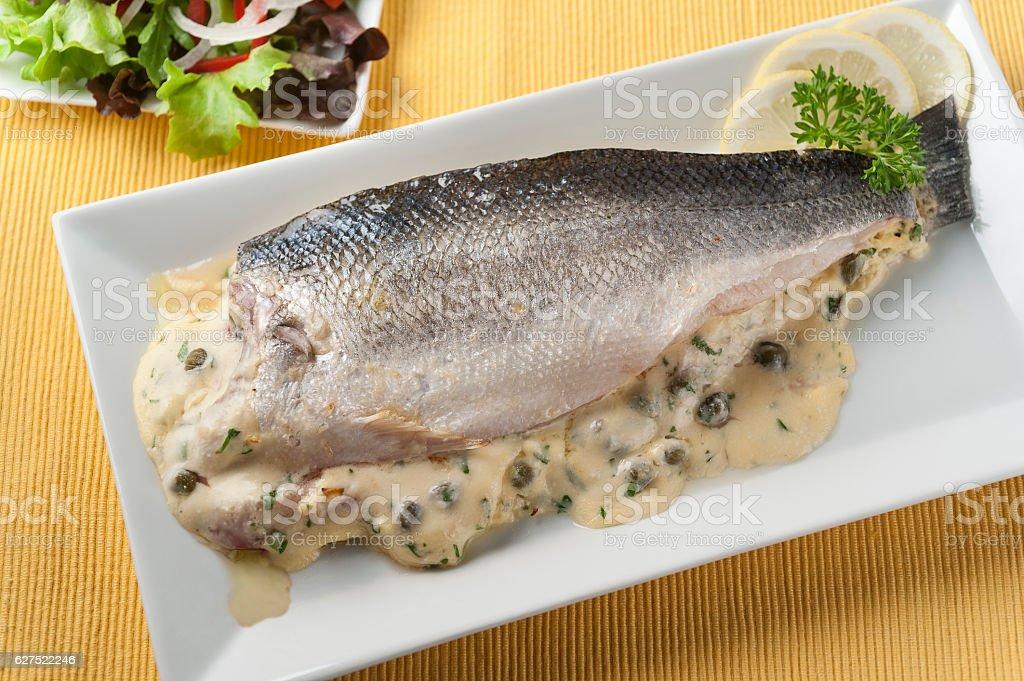 baked stuffed sea bass stock photo