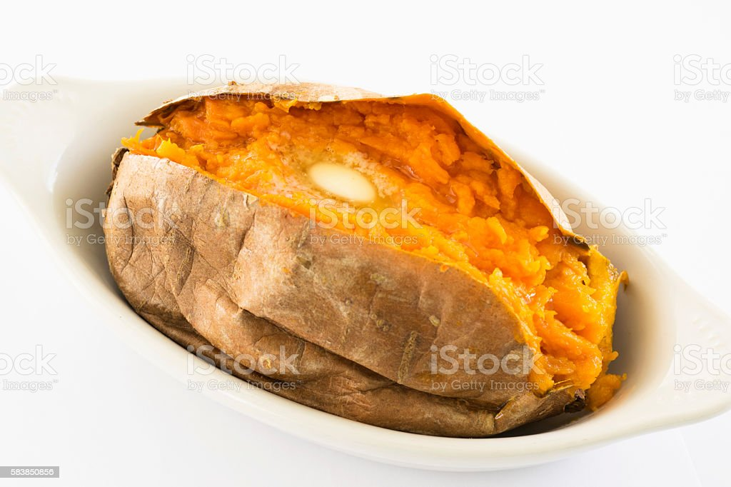 baked sweet potato with butter stock photo