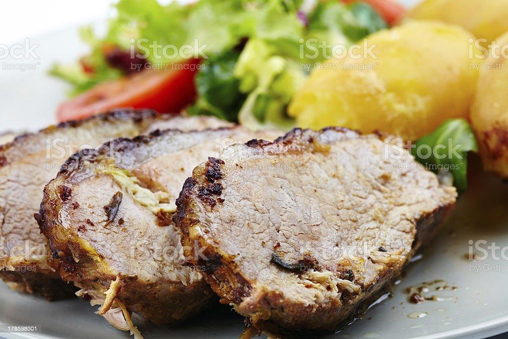 Baked tenderloin with salad stock photo