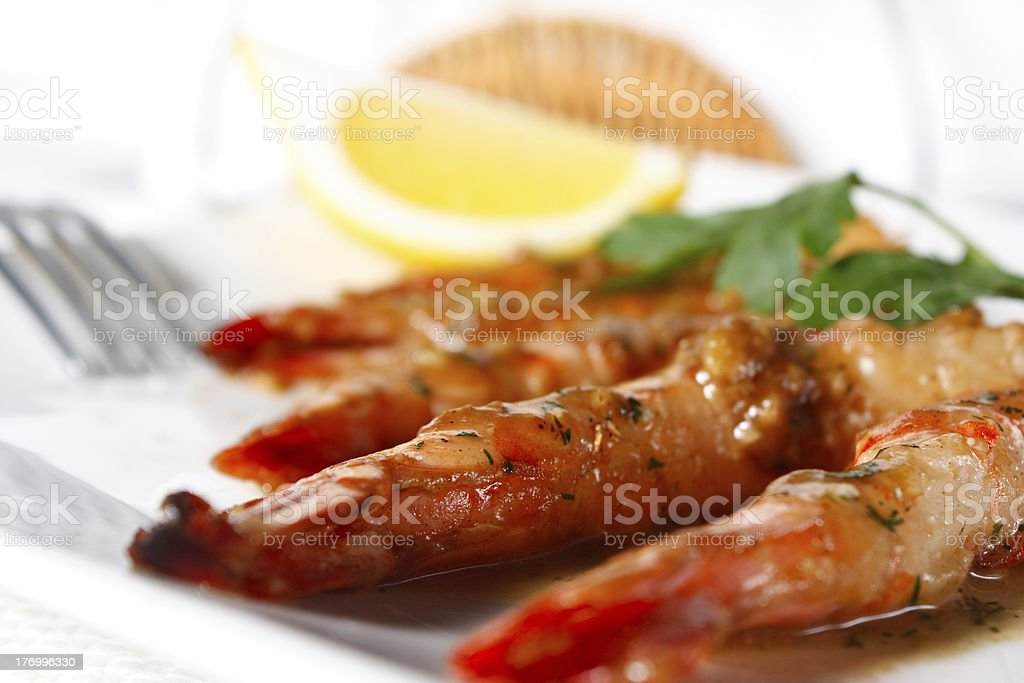Baked Tiger Shrimps with Greens and Lemon royalty-free stock photo