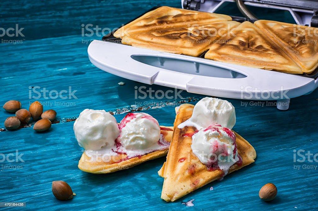 baked toast smeared ice cream in raspberry jam stock photo