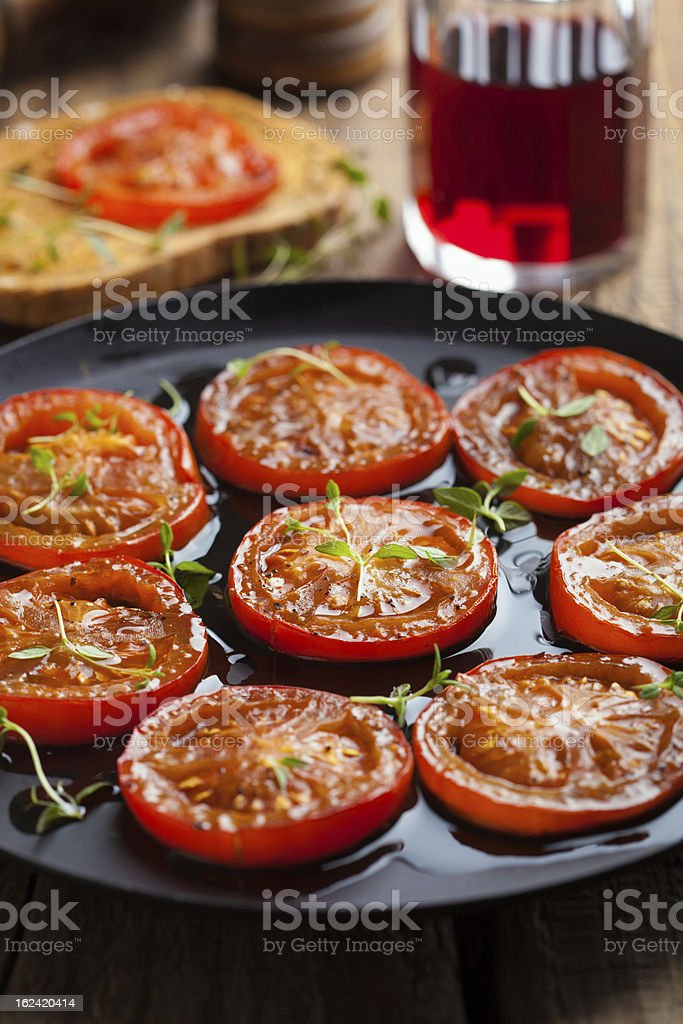 baked tomatoes with herbs and olive oil royalty-free stock photo