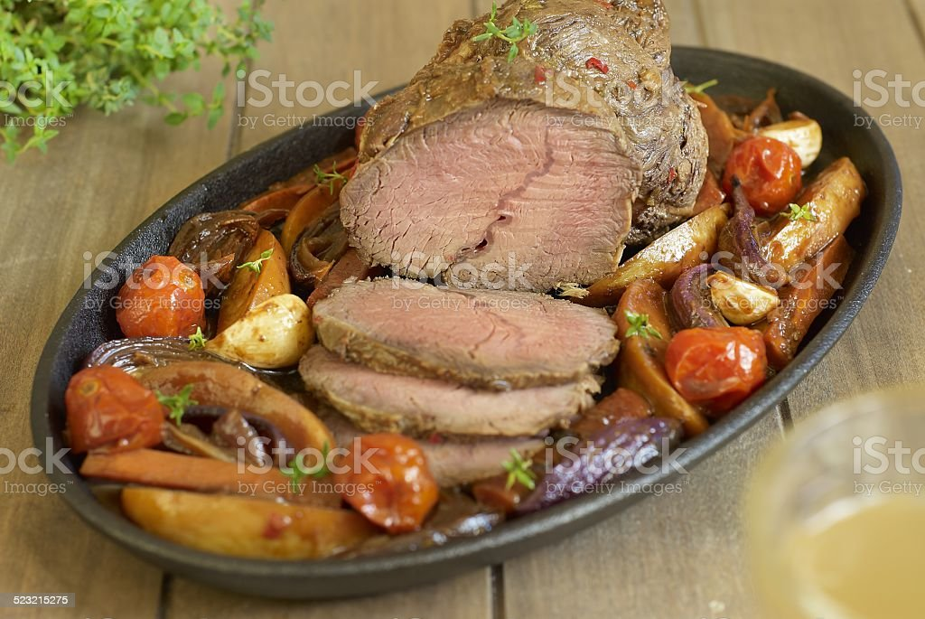 Baked veal with vegetables stock photo