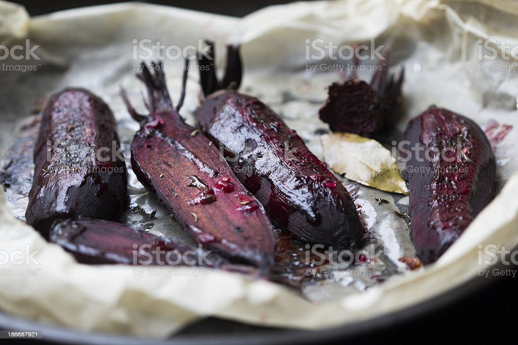 Baked whole beet with olive oil and herbs stock photo