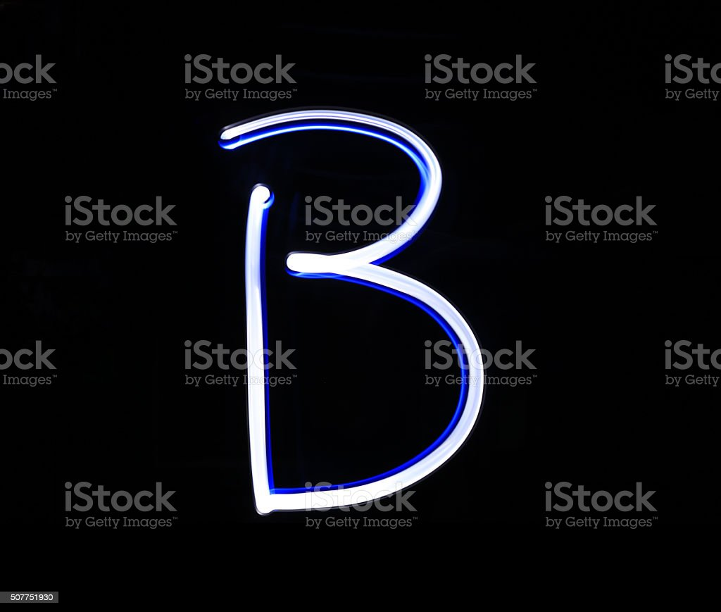 B Baker alphabet hand writing blue light  over black background. stock photo