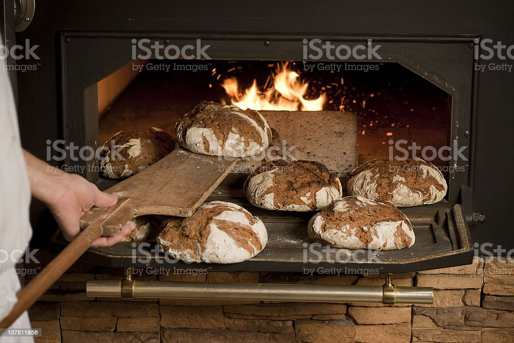 Baker baking bread stock photo