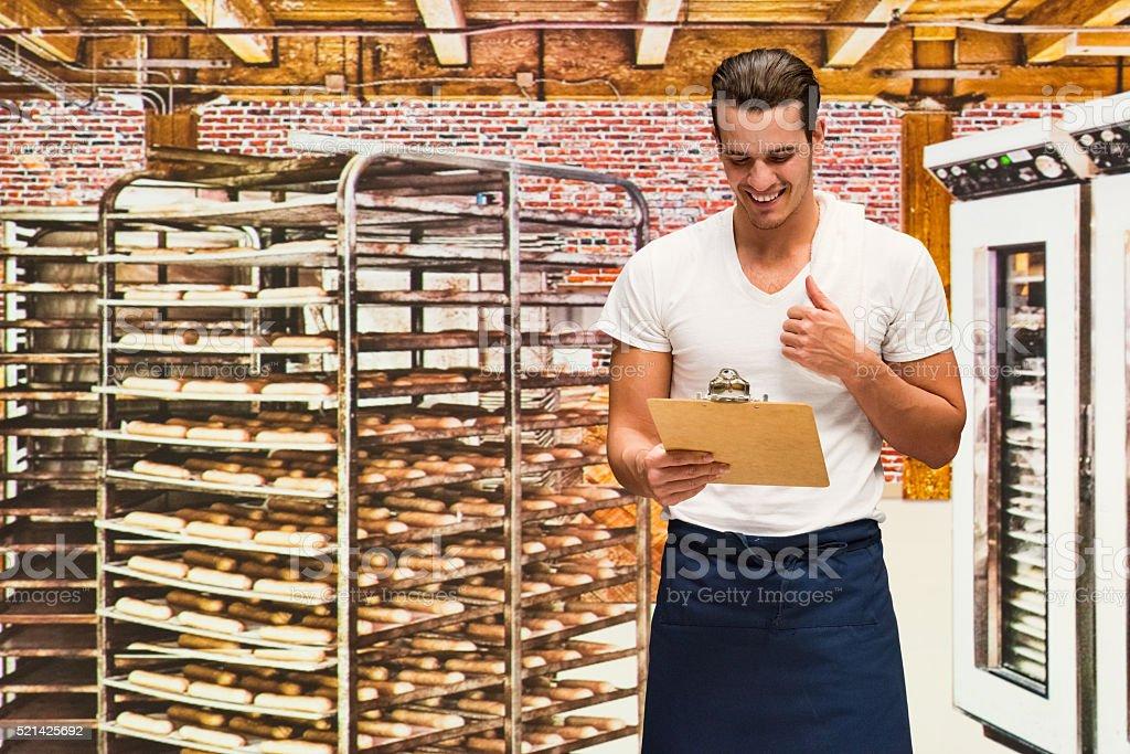 Baker checking order list stock photo