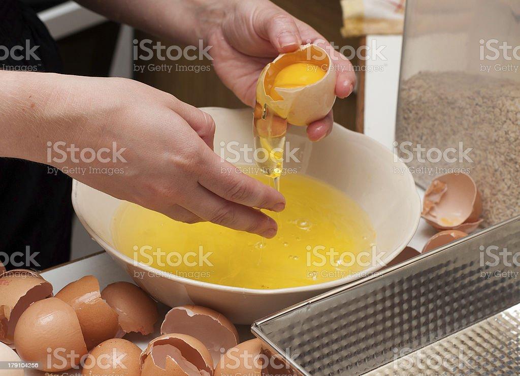 baker cracking an egg. royalty-free stock photo