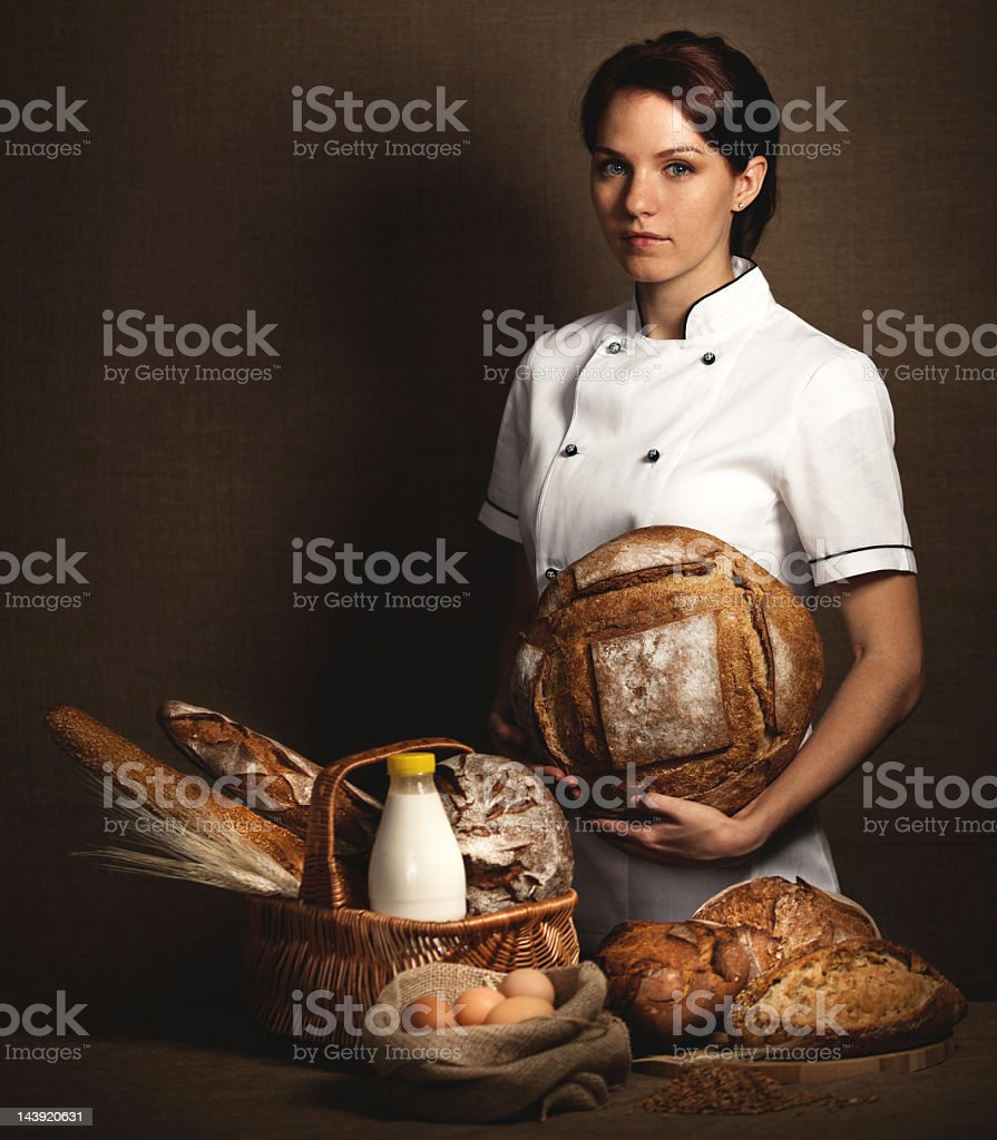 Baker holding in hands fresh baked bread. royalty-free stock photo
