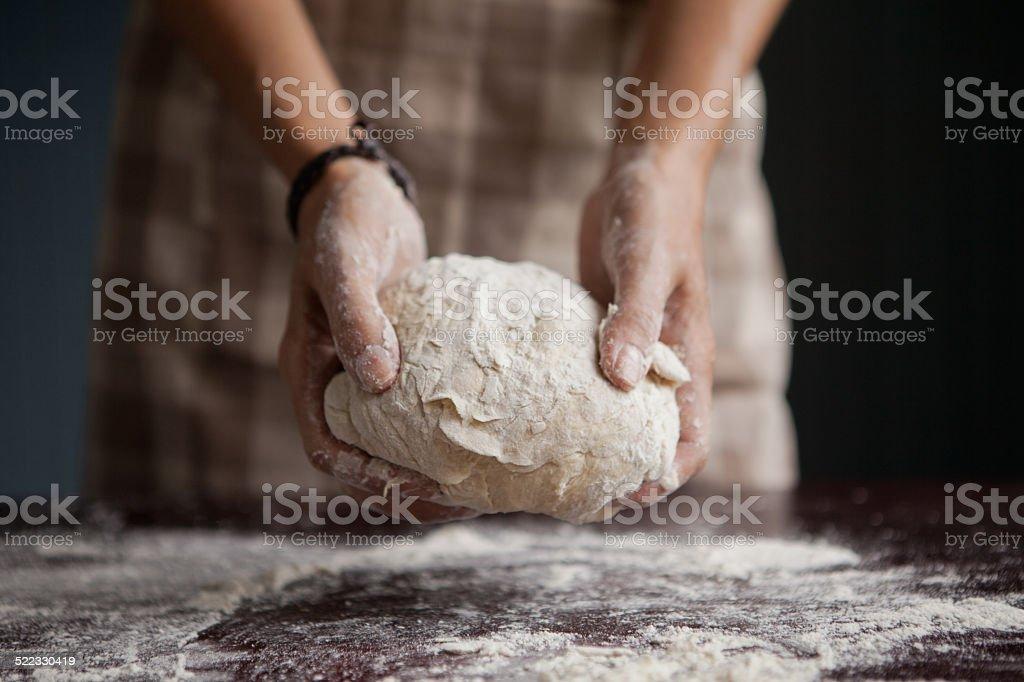 baker kneaded dough stock photo