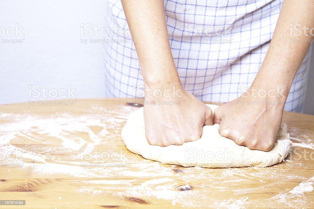 Baker kneading bread dough stock photo