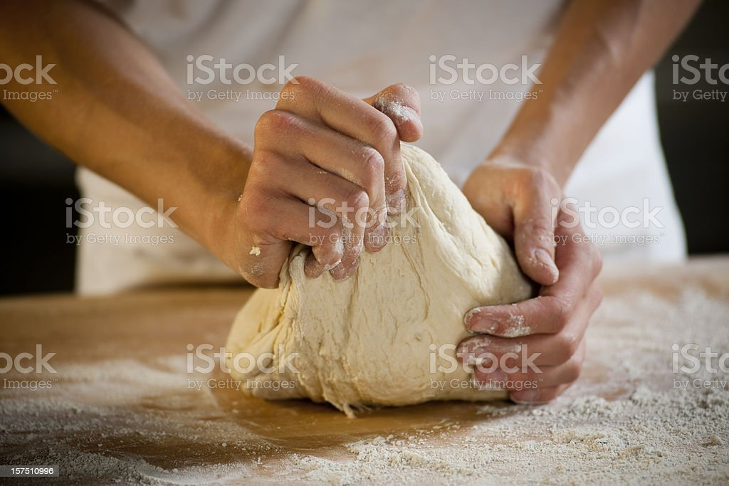 Baker kneading dough stock photo