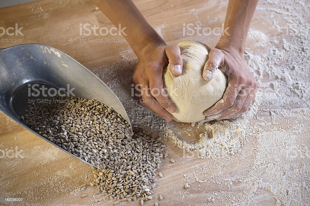 Baker kneading dough royalty-free stock photo
