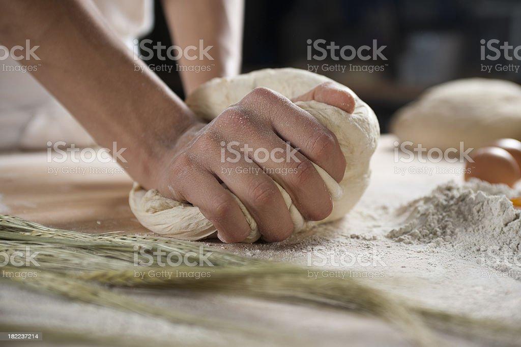 Baker kneading dough royalty-free stock photo