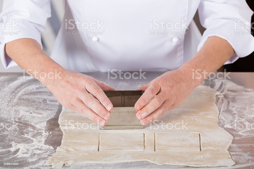 Baker kneading dough stock photo