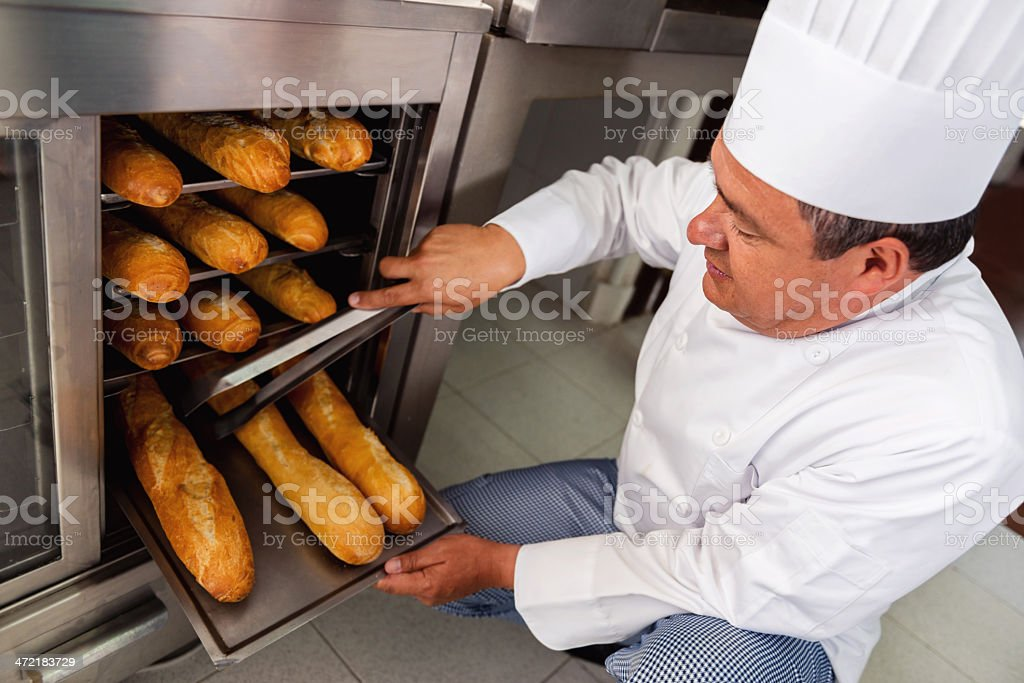 Baker making bread stock photo