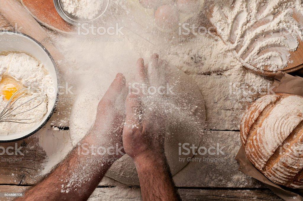 Baker prepares bread stock photo