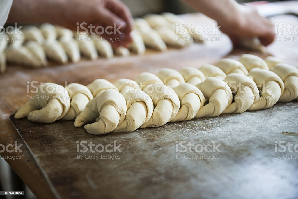Baker Preparing Croissants stock photo