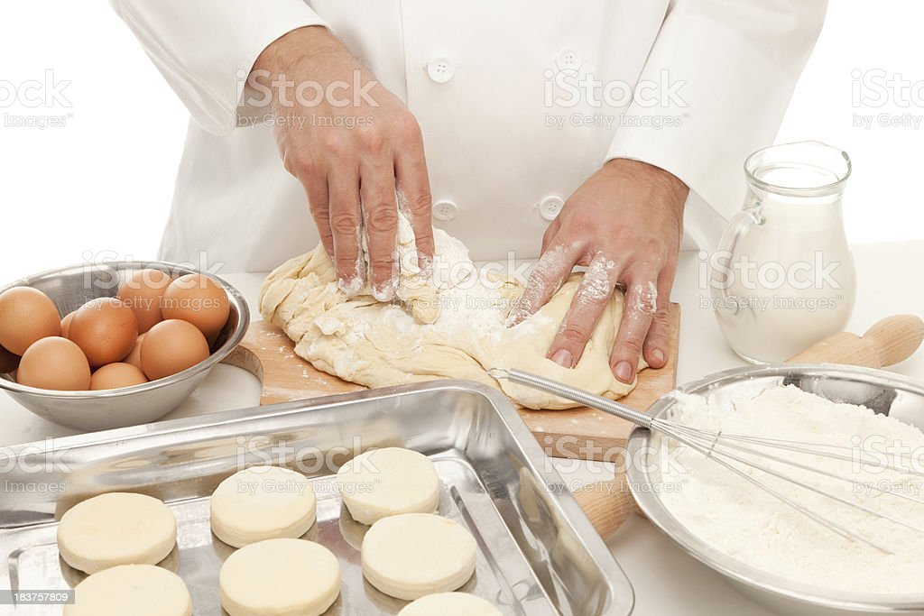 Baker preparing dough for various pastry products royalty-free stock photo