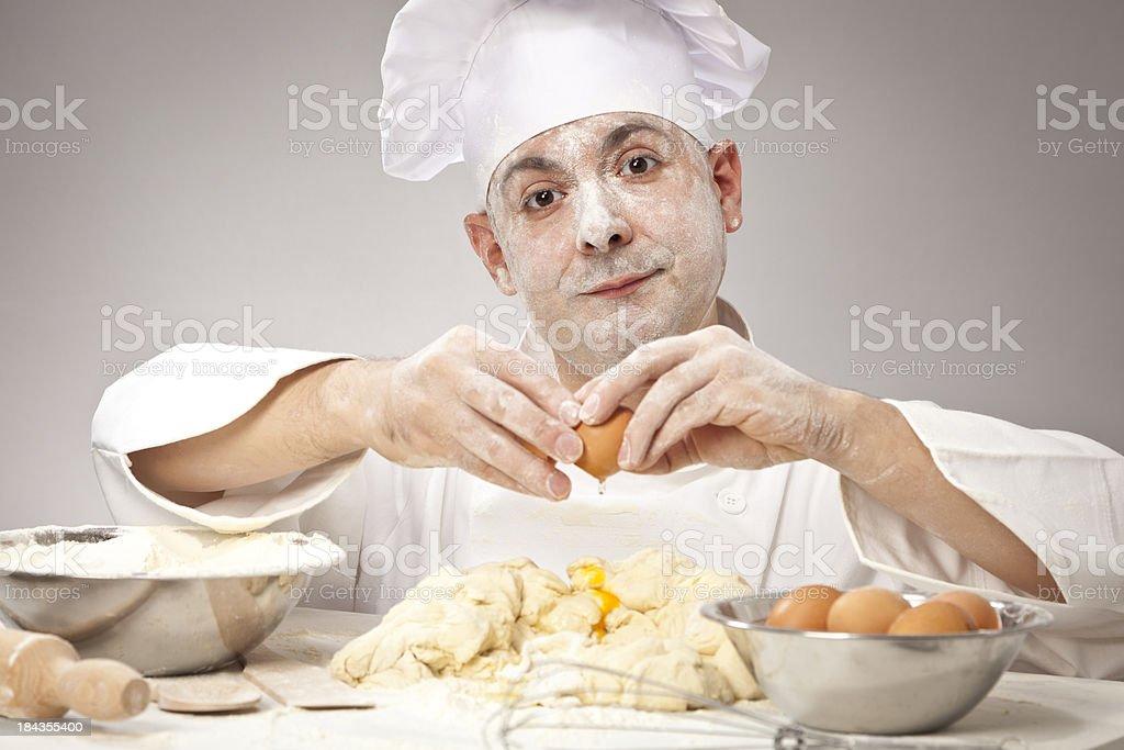 Baker preparing dough royalty-free stock photo