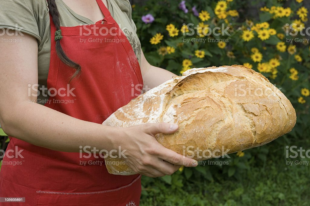 Baker with bread stock photo
