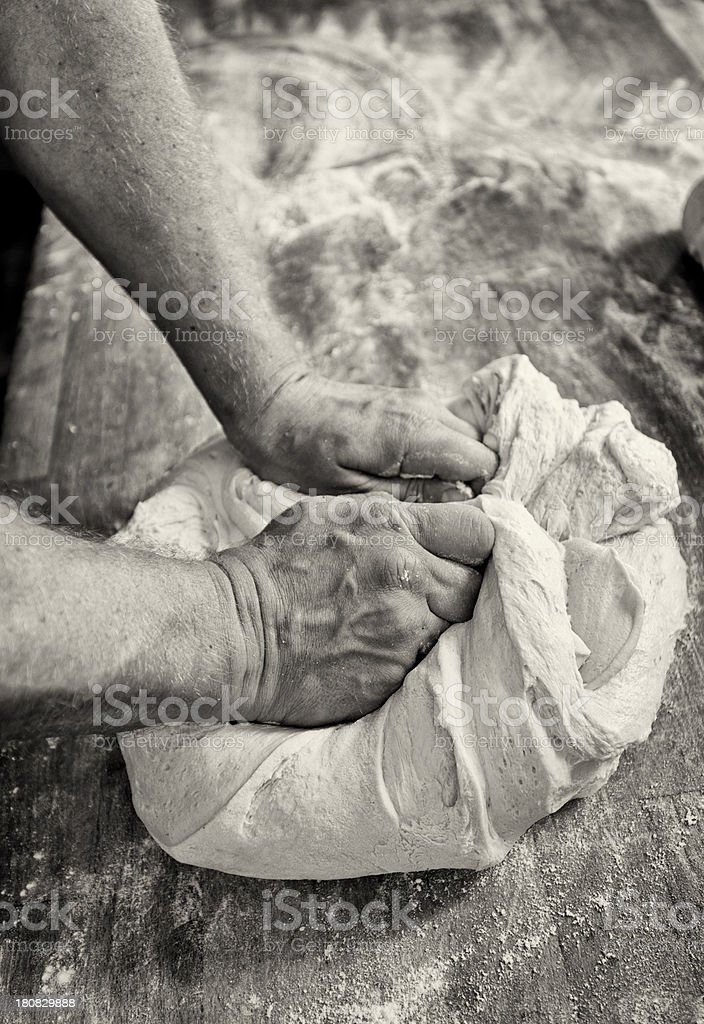 Baker Working The Dough Toned Black and White stock photo