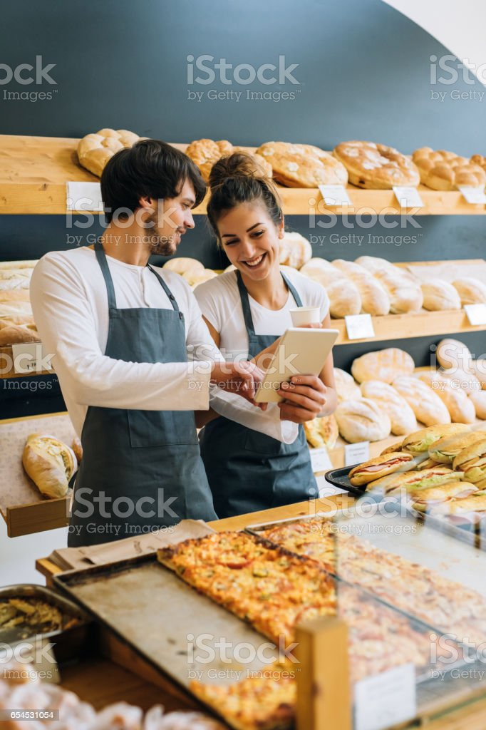 Bakers using a tablet stock photo