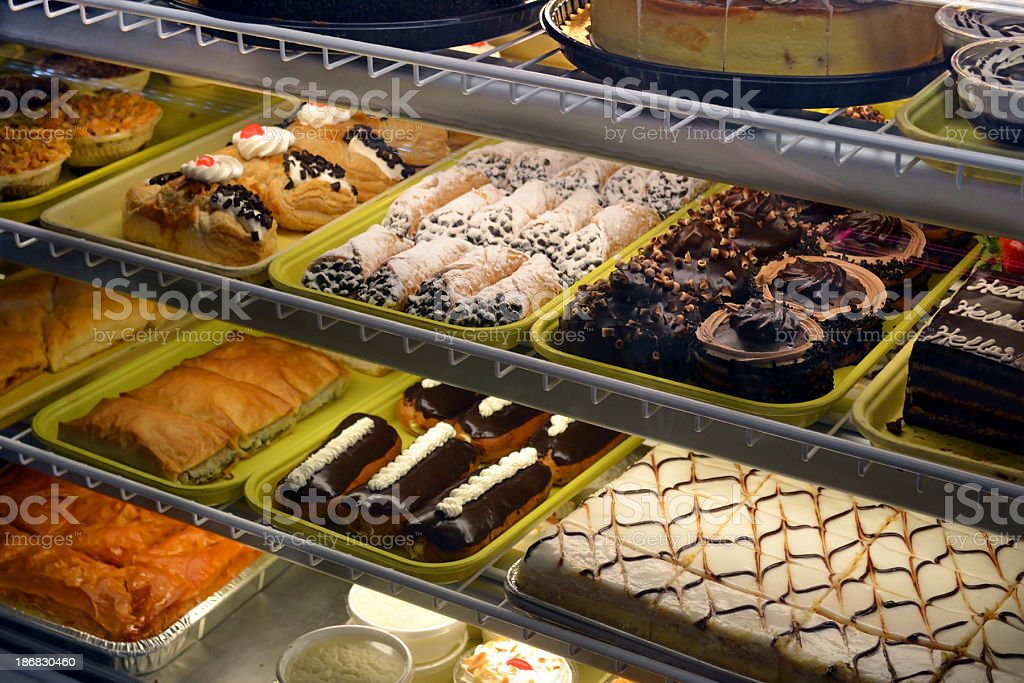 Bakery Case Shelf Lighting Filled with Pastries and Treats stock photo