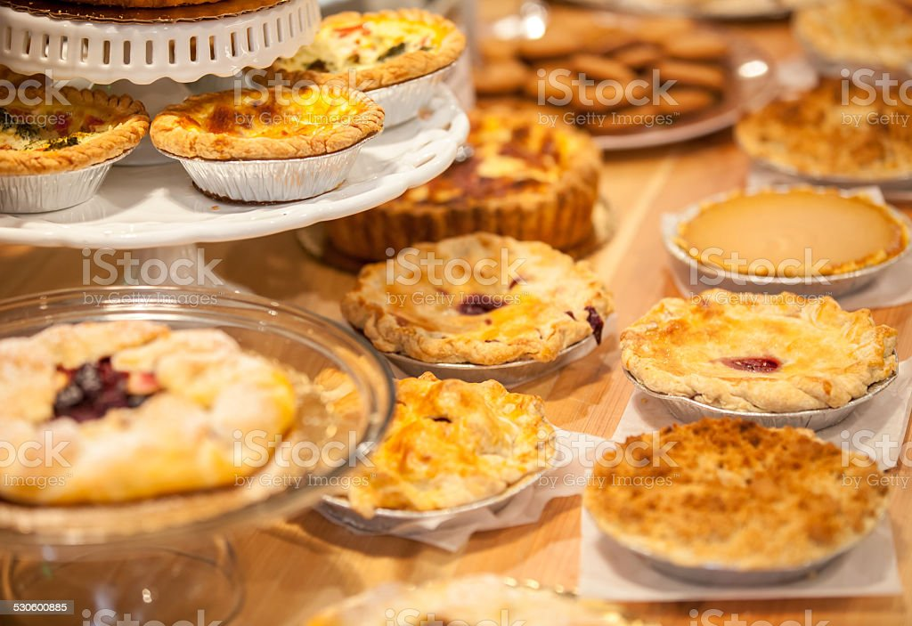 Bakery Counter Full of Assorted Pastries and Pies stock photo