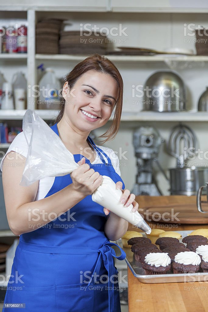 Bakery: Decorating Cupcakes in a Commercial Bakery stock photo