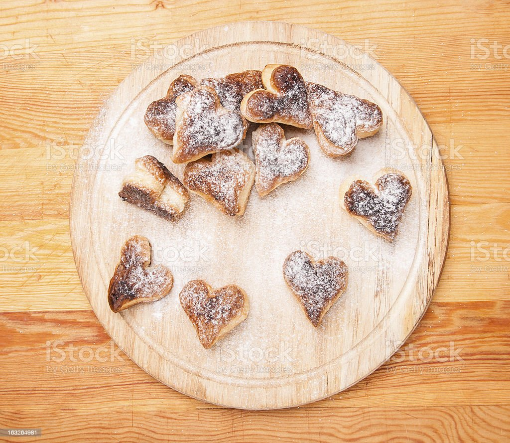 bakery hearts from split pastry with sugar powder on wooden royalty-free stock photo