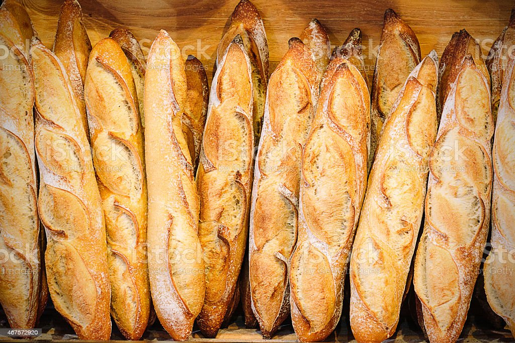 Bakery in France with fresh baguettes or breads on shelf stock photo