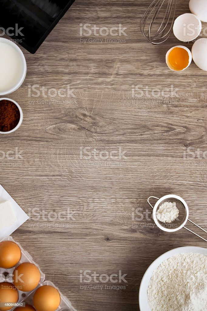 Bakery Ingredients on Wooden Background stock photo