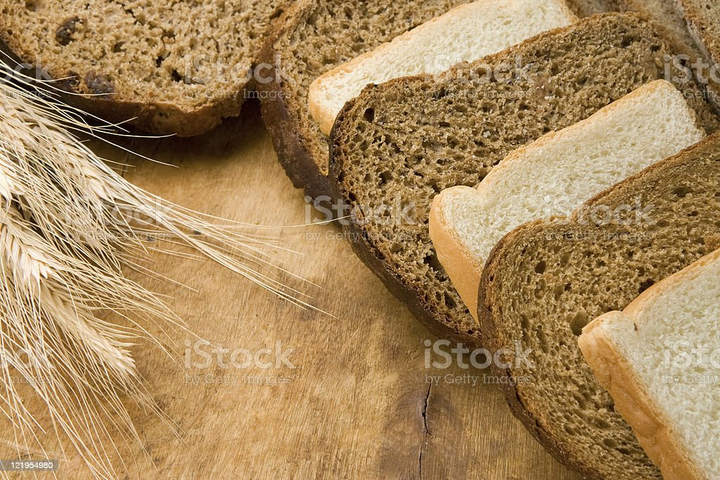 bakery products and grain on wood stock photo