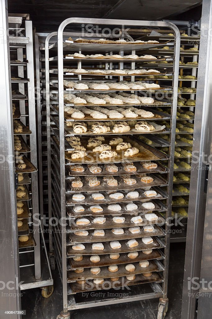 Bakery rack with fresh bread dough in refrigerator stock photo