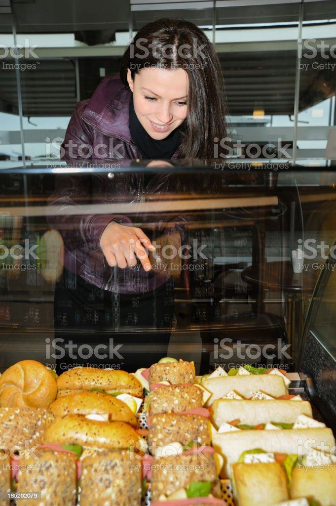 Bakery: Woman choosing sandwich  in Case stock photo