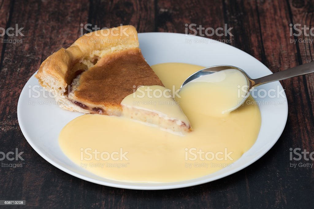 Bakewell pudding and custard stock photo