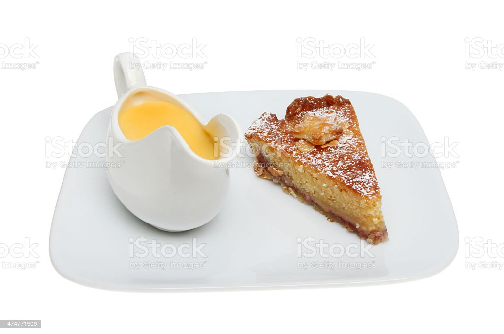 bakewell tart and custard stock photo