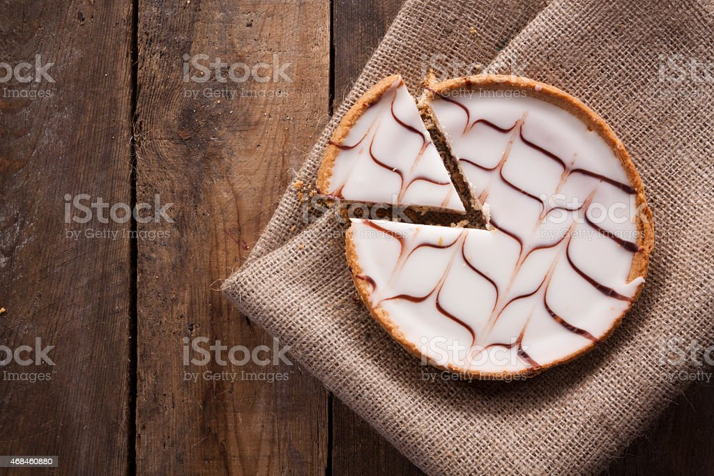 Bakewell Tart on Hessian and Wood stock photo