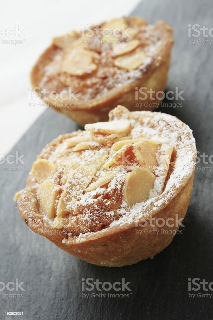 bakewell tart on slate stock photo