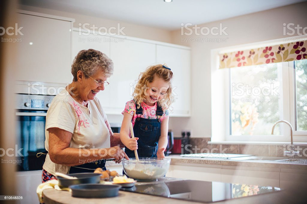 Baking a Cake with Grandma stock photo