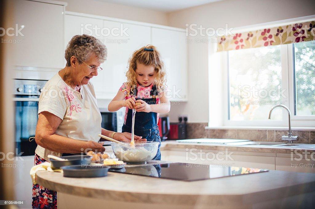 Baking a Cake with Grandma stock photo