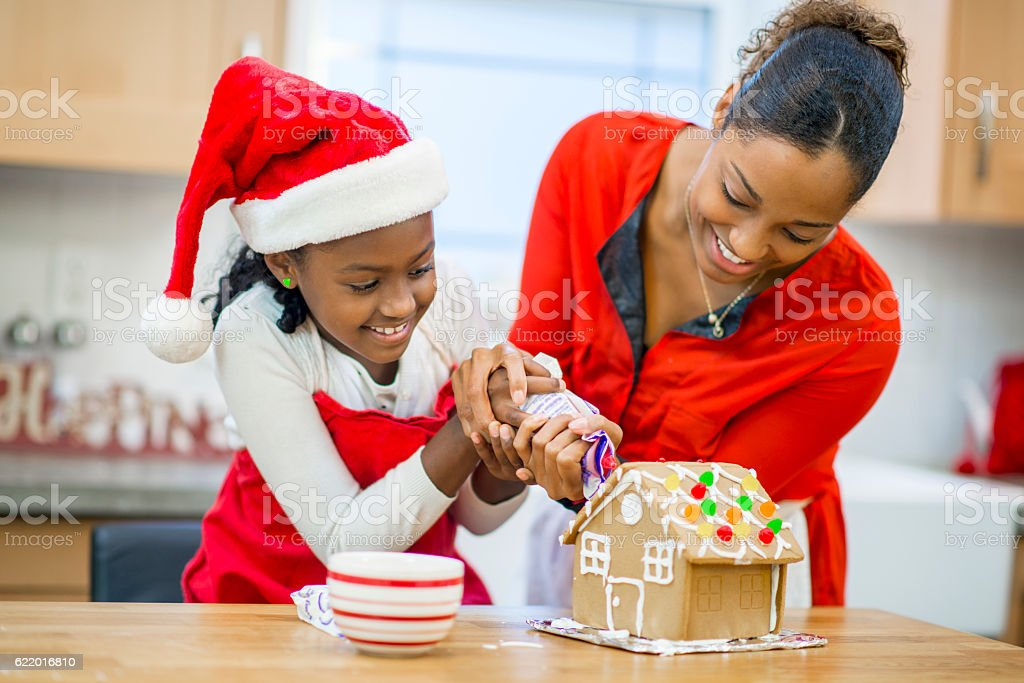 Baking and Decorating a Gingerbread House stock photo