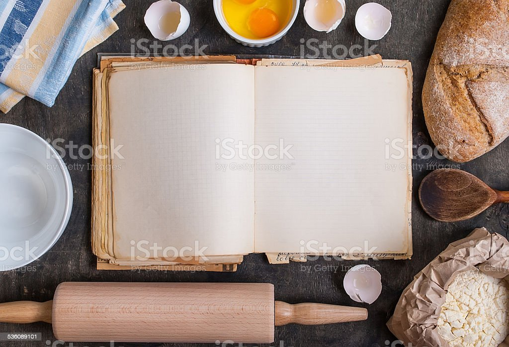 Baking background with blank cook book, flour, rolling pin stock photo