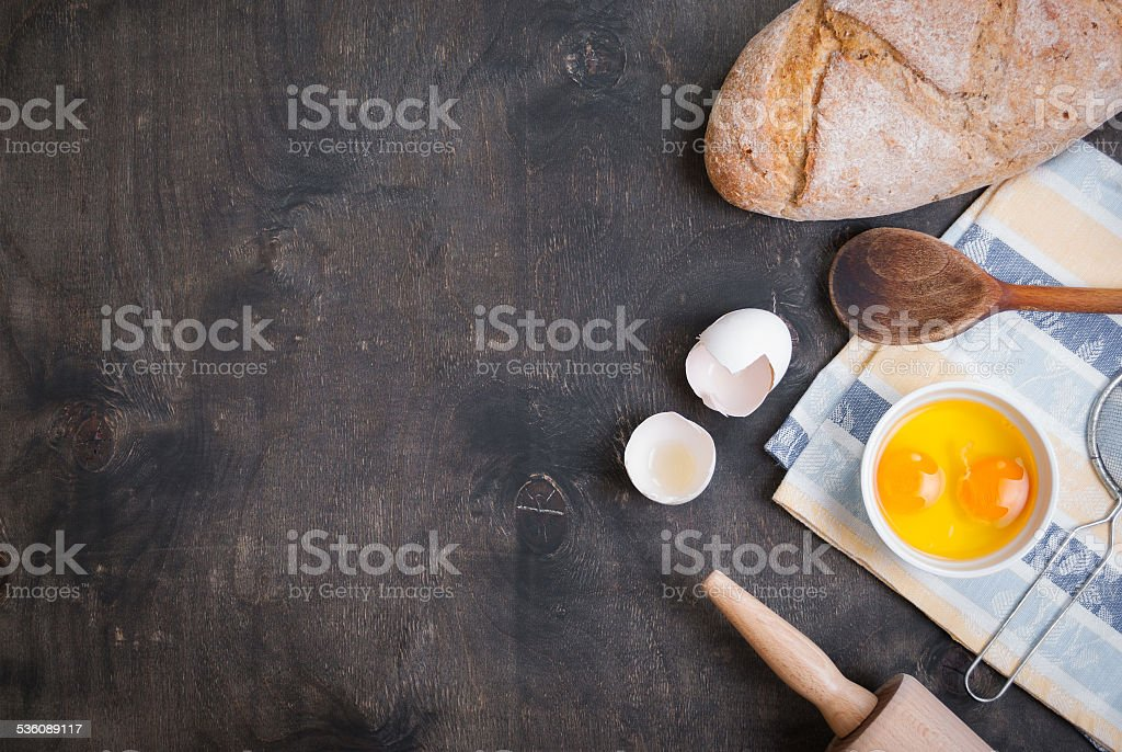 Baking background with eggshell, bread, flour, rolling pin stock photo