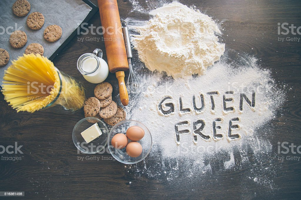 Baking background with 'Gluten free' writting in flour stock photo